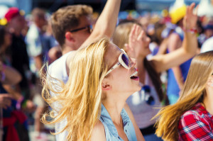 45742533 - group of beautiful teens at concert at summer festival